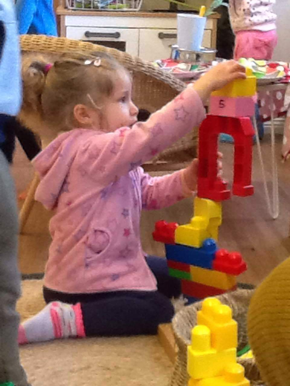 Alivia made a tower out of duplo, she worked on this for a while.