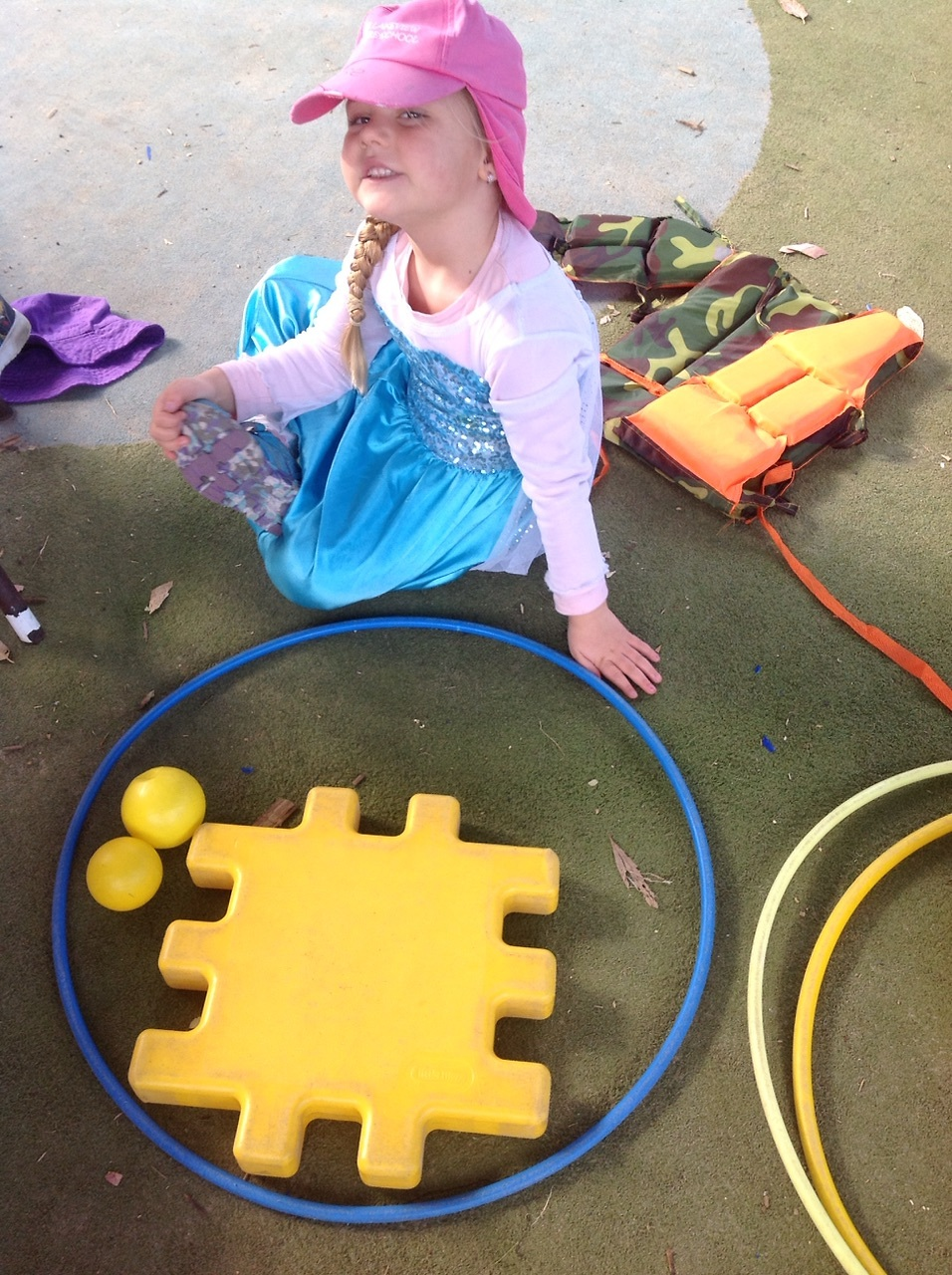 The children love creating with the loose parts, here is Ellise using the large loose parts outside to create.